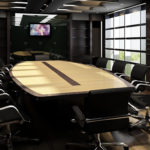 Meeting room with a large wooden desk