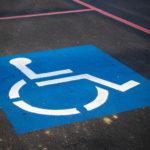 A disabled parking spot sign