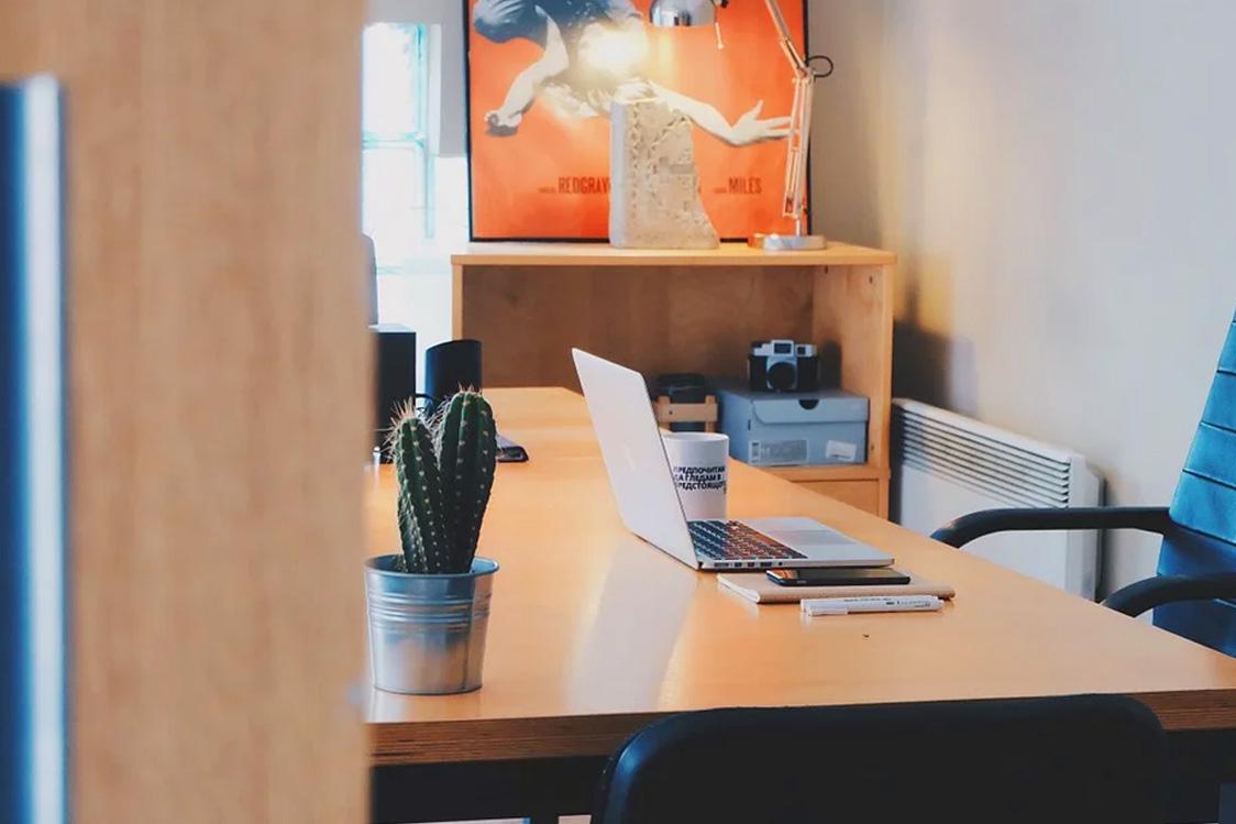 A laptop centred on a tidy desk